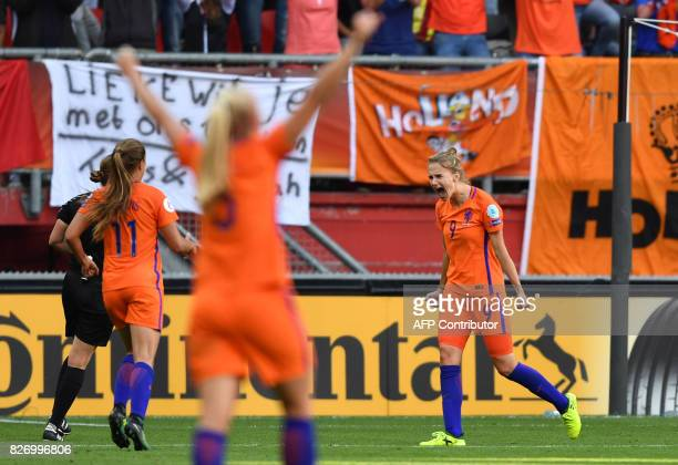 Netherlands' forward Vivianne Miedema celebrates with teammates after scoring a goal during the UEFA Womens Euro 2017 football tournament final match...