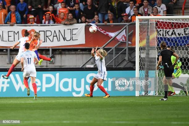 Netherlands' forward Vivianne Miedema heads the ball and scores a goal during the UEFA Womens Euro 2017 football tournament semifinal match between...