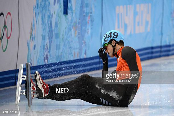 Netherlands' Freek van der Wart falls in the Men's Short Track 500 m Quarterfinals at the Iceberg Skating Palace during the Sochi Winter Olympics on...