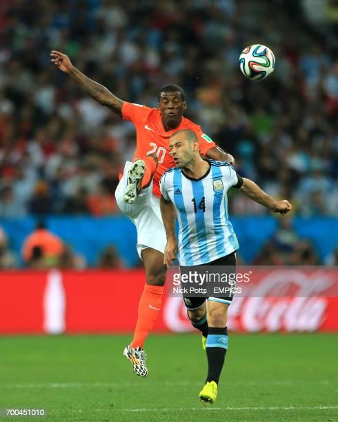 Netherland's Georginio Wijnaldum and Argentina's Javier Mascherano battle for the ball in the air