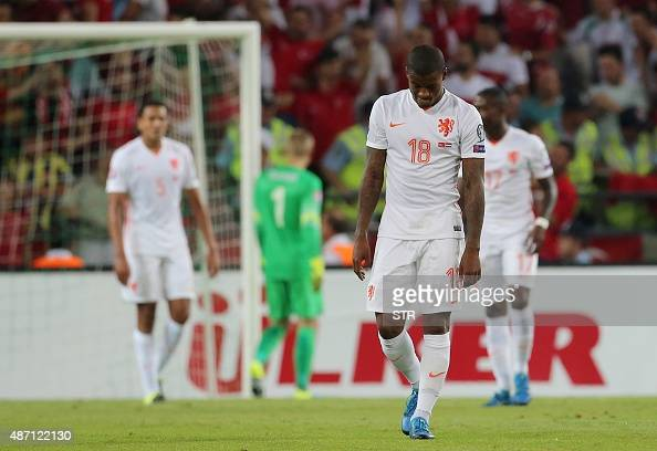 Netherlands' Georgino Wijnaldum gestures as Turkey's players celebrate after scoring a goal during the Euro 2016 qualifying football match between...