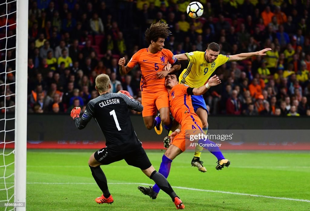 TOPSHOT - (L-R) Netherlands' goalkeeper Jasper Cillessen, Netherlands' defender Nathan Ake, Netherlands' defender Karim Rekik, and Sweden's forward Marcus Berg vie for the ball during the FIFA World Cup 2018 football qualification, Group A, match between the Netherlands and Sweden at the Amsterdam Arena in Amsterdam on October 10, 2017. /