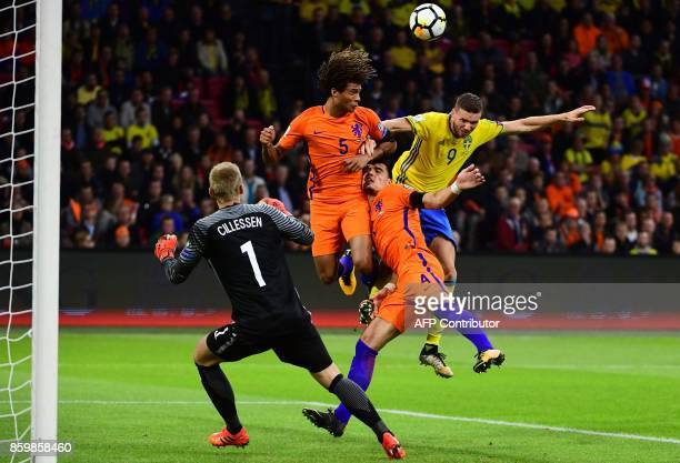 TOPSHOT Netherlands' goalkeeper Jasper Cillessen Netherlands' defender Nathan Ake Netherlands' defender Karim Rekik and Sweden's forward Marcus Berg...