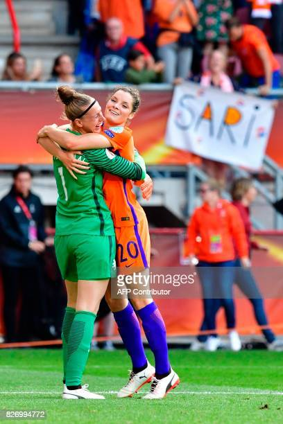 Netherlands' goalkeeper Sari van Veenendaal hugs Netherlands' defender Dominique Janssen as they celebrate after winning the UEFA Womens Euro 2017...