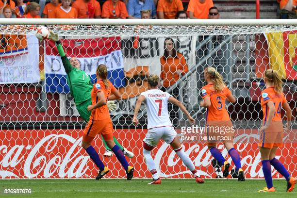 Netherlands' goalkeeper Sari van Veenendaal stops the ball during the UEFA Womens Euro 2017 football tournament final match between Netherlands and...
