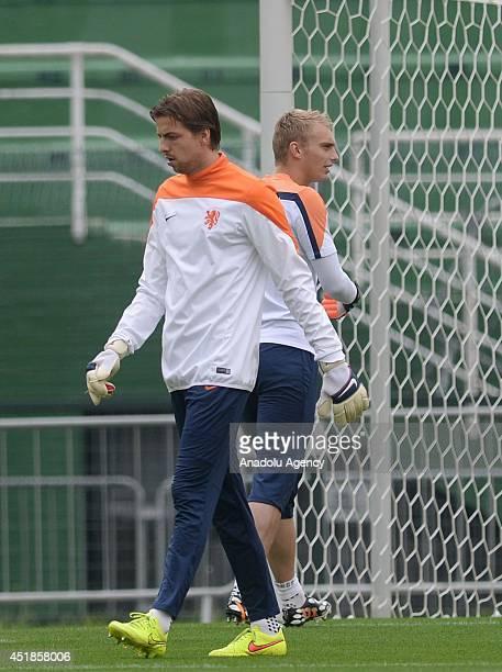 Netherlands' goalkeepers Tim Krul and Jasper Cillessen attend a training session at Pacaembu Stadium in Sao Paulo Brazil on July 08 2014 Netherlands...