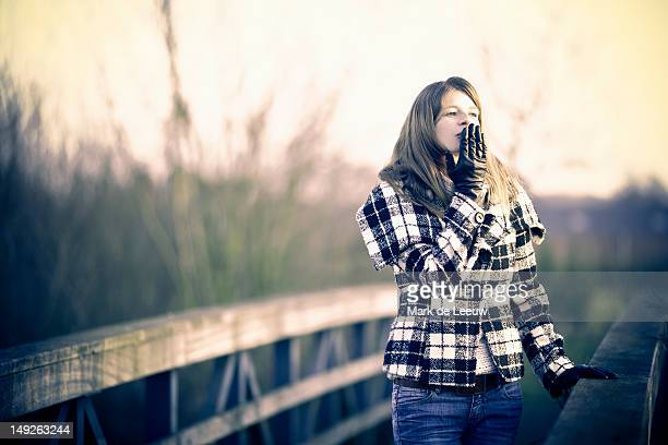 Netherlands, Goirle, Young woman walking in winter sun