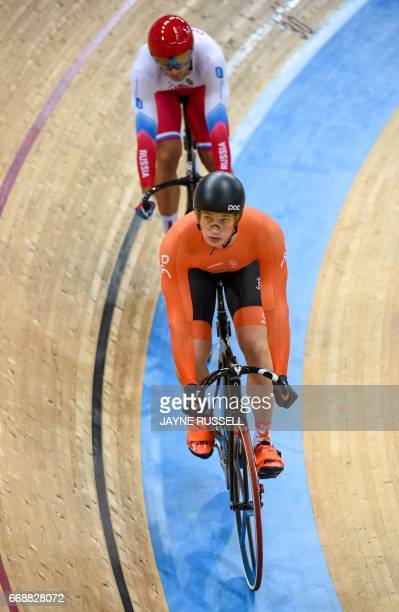 Netherlands Harrie Lavreysen competes against eventual gold medallist Russia's Denis Dmitriev during the Men's Sprint Final at the 2017 Track Cycling...