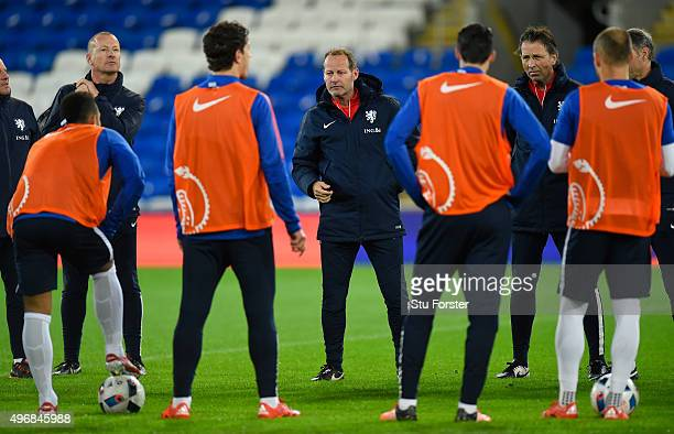 Netherlands head coach Danny Blind speaks to his players during the Netherlands open training session ahead of their friendly international against...