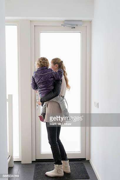 Netherlands, Helvoirt, Mother holding son (4-5)