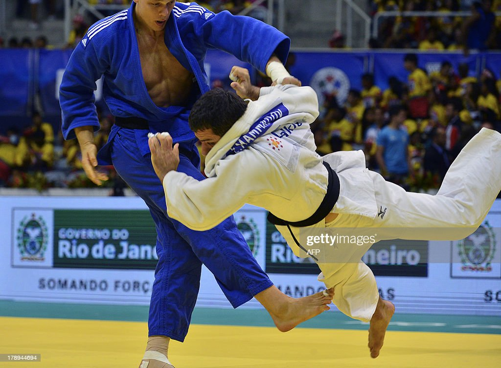 Netherlands' Henk Grol (L) and Azerbaijan's Elkhan Mammadov compete in the Men's -100kg category final, during the IJF World Judo Championship, in Rio de Janeiro, Brazil, on August 31, 2013.