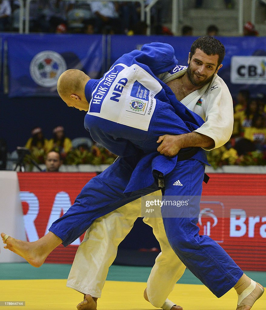 Netherlands' Henk Grol (front) and Azerbaijan's Elkhan Mammadov compete in the Men's -100kg category final, during the IJF World Judo Championship, in Rio de Janeiro, Brazil, on August 31, 2013.