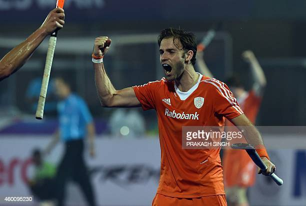 Netherlands hockey player Rogier Hofman celebrates a goal against Germany during their Hero Hockey Champions Trophy 2014 match at Kalinga Stadium in...