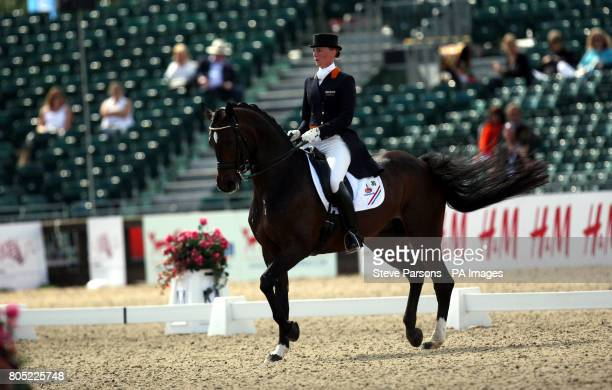 Netherlands' Imke SchellekensBartels riding Hunter Douglas Sunrise competes during day one of The European Show Jumping and Dressage Championships...