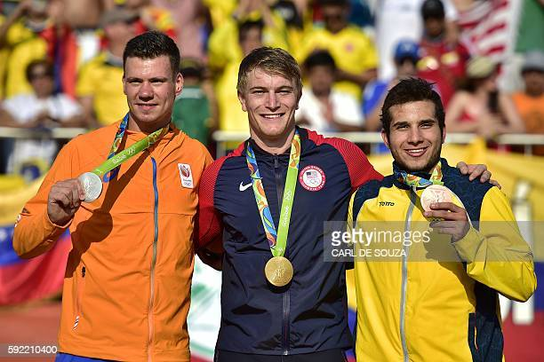 Netherlands' Jelle Van Gorkom US Connor Fields and Colombia's Carlos Alberto Ramirez Yepes celebrate on the podium of the men's BMX cycling event of...