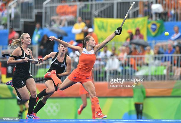 TOPSHOT Netherlands' Kelly Jonker goes for the ball during the womens's field hockey New Zealand vs Netherlands match of the Rio 2016 Olympics Games...
