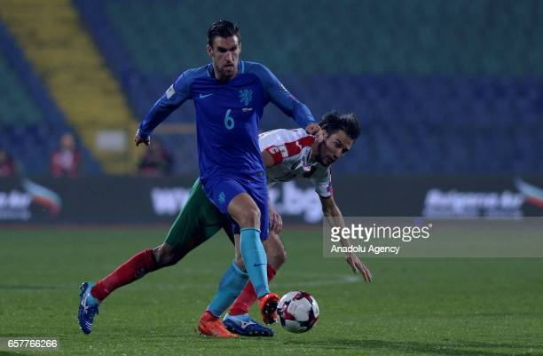 Netherlands Kevin Strootman vies for the ball against Ivelin Popov from Bulgaria during their FIFA World Cup 2018 Group A qualifying soccer match...