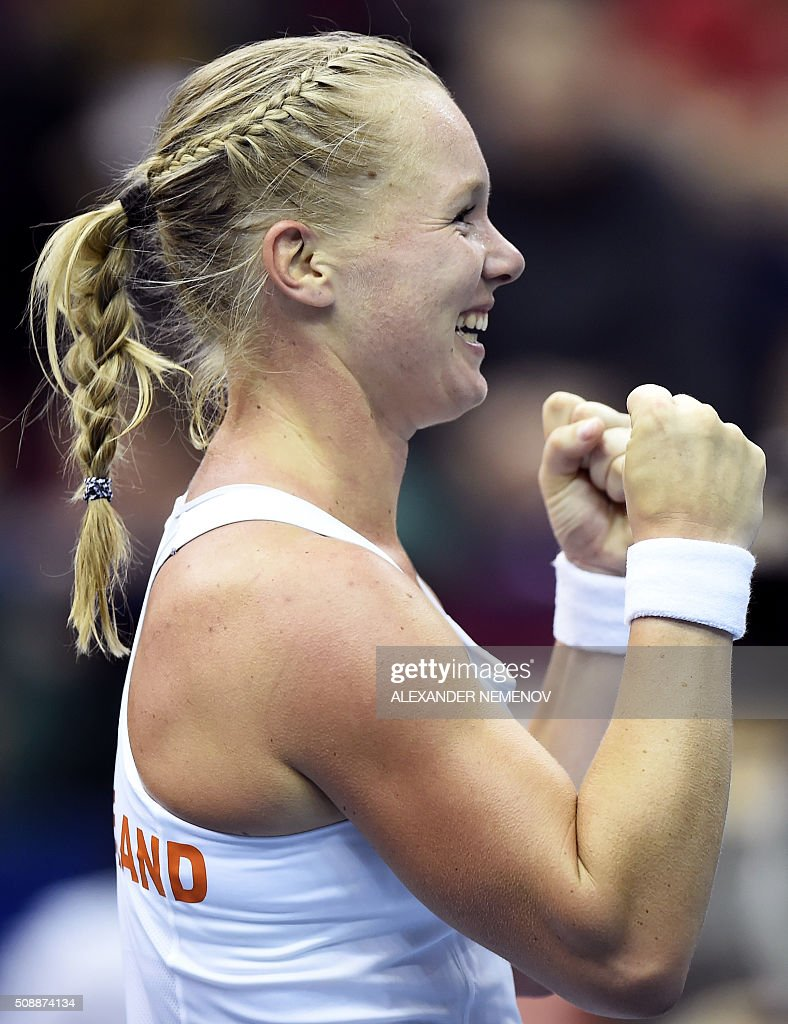 Netherland's Kiki Bertens celebrates after scoring the third point of her team following her victory over Russia's Svetlana Kuzntetsova during the Federation Cup tennis world group first round match between Russia and Netherlands in Moscow on February 7, 2016. / AFP / ALEXANDER NEMENOV
