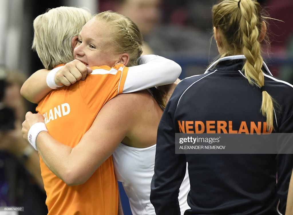 Netherland's Kiki Bertens (C) celebrates with her teammates after scoring the third point of her team following her victory over Russia's Svetlana Kuzntetsova during the Federation Cup tennis world group first round match between Russia and Netherlands in Moscow on February 7, 2016. / AFP / ALEXANDER NEMENOV