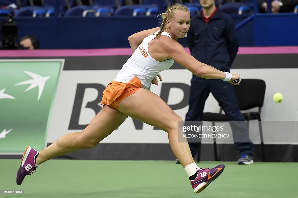 Netherland's Kiki Bertens eyes the ball for a return to Russia's Svetlana Kuznetsova during the Federation Cup tennis world group first round match between Russia and Netherlands in Moscow on February 7, 2016. / AFP / ALEXANDER NEMENOV