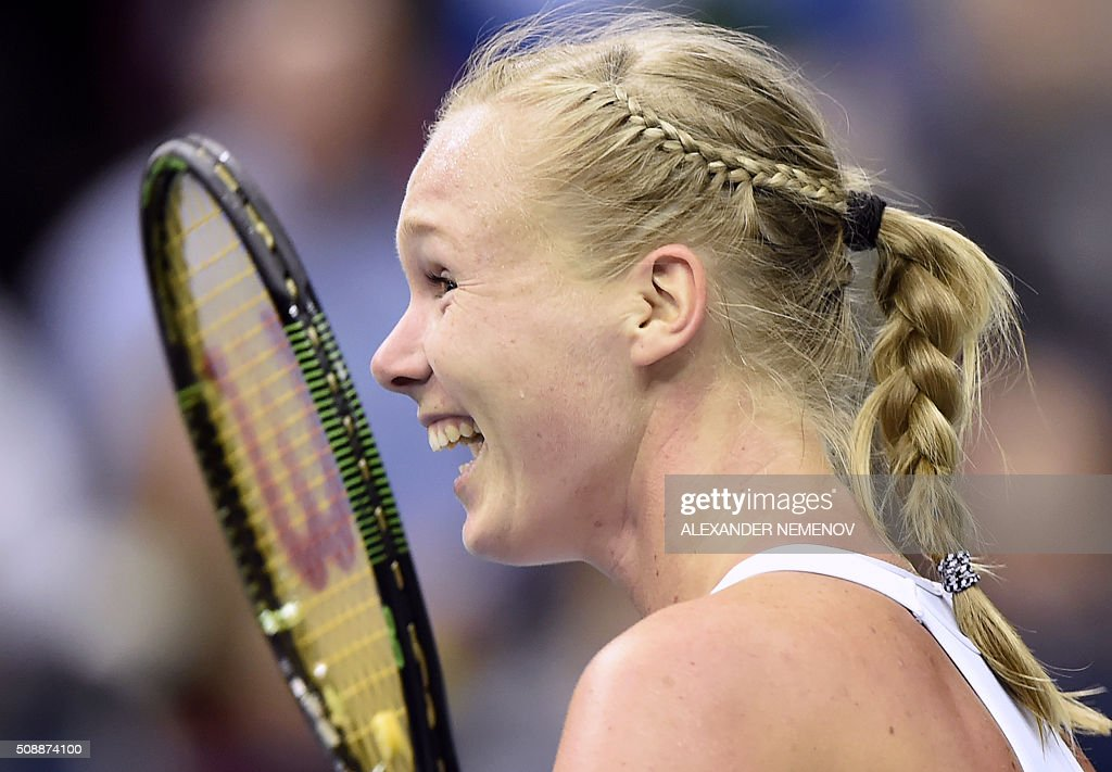Netherland's Kiki Bertens reacts after scoring the third point of her team following her victory over Russia's Svetlana Kuzntetsova during the Federation Cup tennis world group first round match between Russia and Netherlands in Moscow on February 7, 2016. / AFP / ALEXANDER NEMENOV