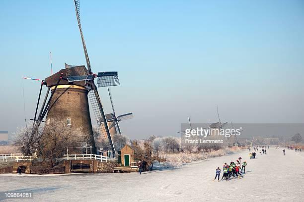 Netherlands, Kinderdijk, People ice skating