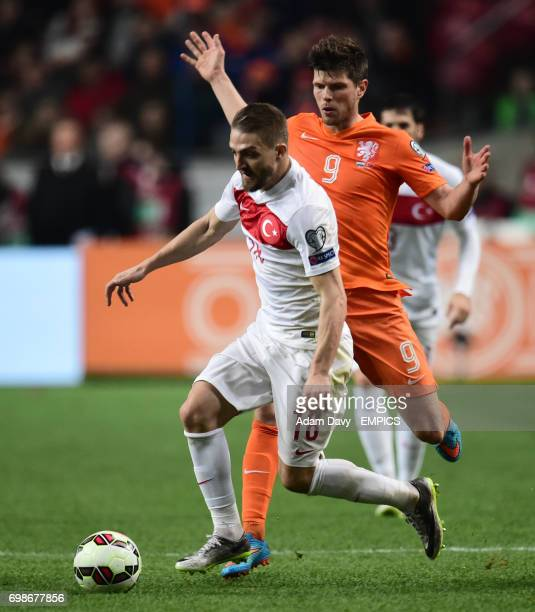 Netherland's Klaas Jan Huntelaar is beaten by Turkey's Caner Erkin