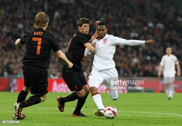 Netherlands' KlaasJan Huntelaar and England's Daniel Sturridge battle for the ball