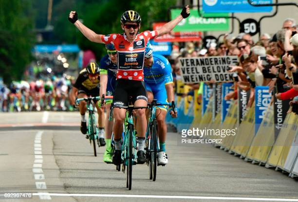 Netherlands' Koen Bouwman second best climber's polka dot jersey celebrates as he crosses the finish line during the 184 km third stage of the 69th...