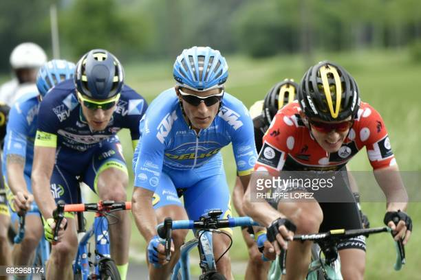 Netherlands' Koen Bouwman second best climber's polka dot jersey rides ahead of Lituania's Evaldas Siskeviciu and Belgium's Frederik Backaert during...