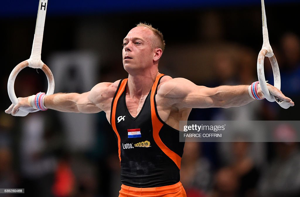 Netherlands Lambertus Van Gelder performs during the Mens Rings competition of the European Artistic Gymnastics Championships 2016 in Bern, Switzerland on May 29, 2016. / AFP / FABRICE