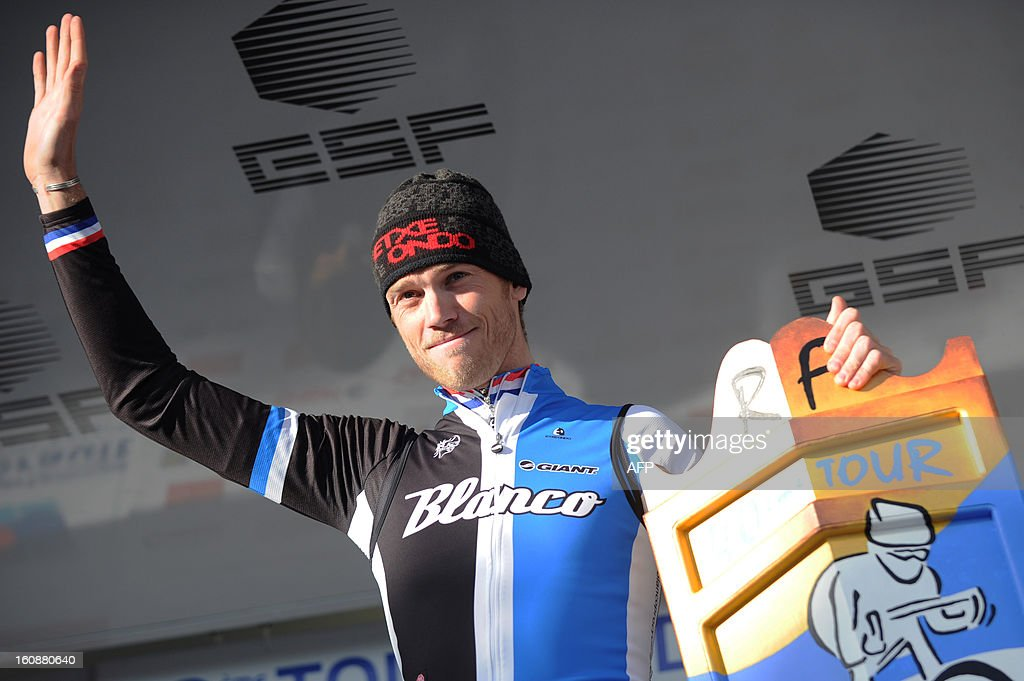 Netherland's Lars Boom celebrates on the podium after winning the second stage, a 24km individual time trial, of the 40th edition of the Tour Mediteranneen cycling race from Cap d'Agde to Sete on February 7, 2013 in Sete, southern France. Boom is a new leader of the race.