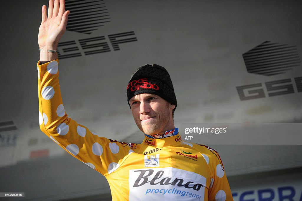 Netherland's Lars Boom celebrates on the podium after winning the second stage, a 24km individual time trial, of the 40th edition of the Tour Mediterraneen cycling race from Cap d'Agde to Sete on February 7, 2013 in Sete, southern France. Boom is a new leader of the race.