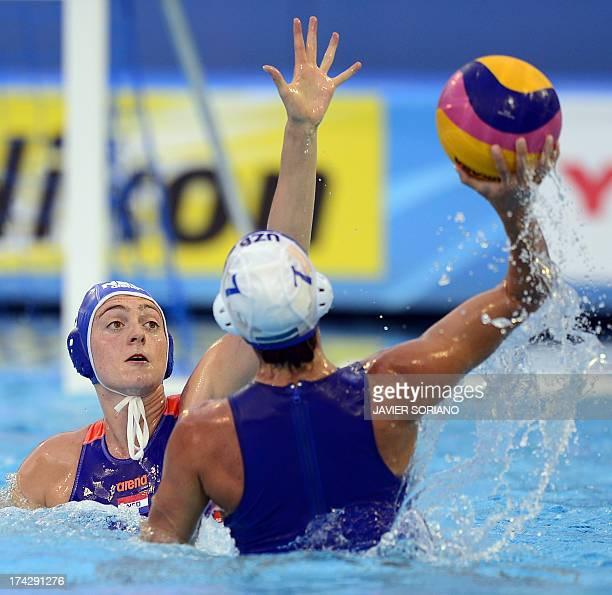 Netherlands' Lefke van Belkum vies with Uzbekistan's Natalya Plyusova during the preliminary round match between Uzbekistan and Netherlands in the...