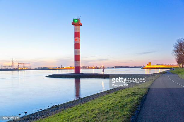 Netherlands, Lighthouse and harbour entrance of Rotterdam in the evening
