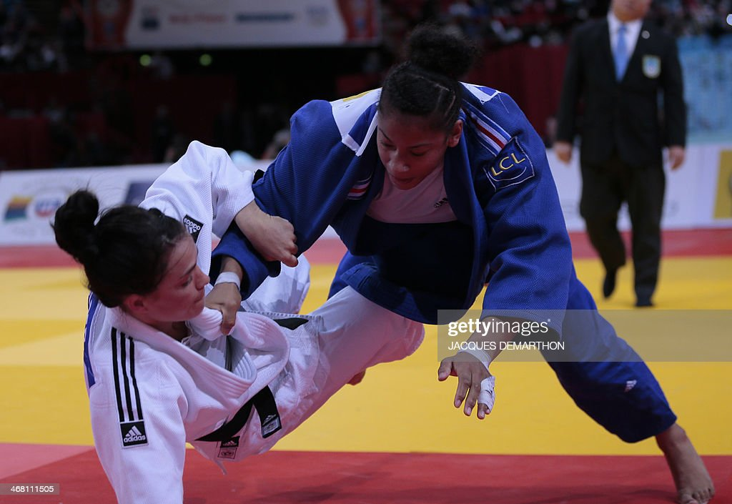 Netherlands' Linda Bolder competes with France's Fanny Estelle Posvite during the women's 70kg final match at the 2014 Paris Judo Grand Slam...