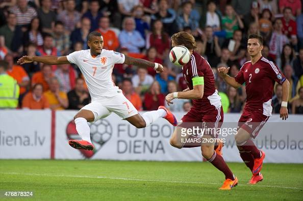 Netherland's Luciano Narsingh vies with Latvia's Kaspars Gorkss and Vitalijs Maksimenko during the UEFA Euro 2016 Group A qualifying football match...