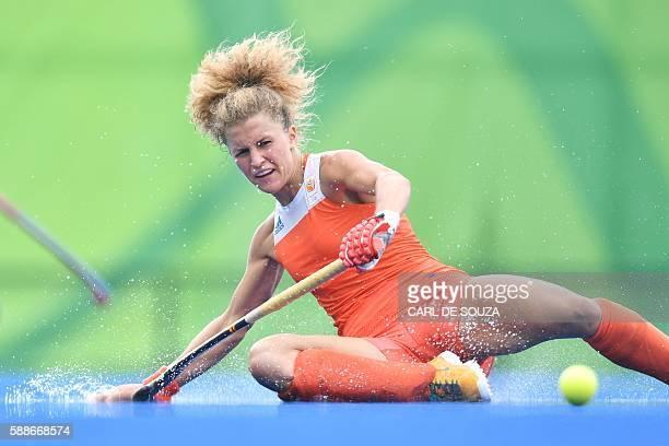 TOPSHOT Netherlands' Maria Verschoor slips on the rain water during the womens's field hockey New Zealand vs Netherlands match of the Rio 2016...