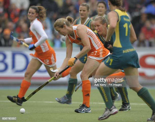 Netherland's Marilyn Agliotti runs through the Australian defence during the Rabo FIH Women's Champions Trophy match at the Wagener Stadium Amsterdam
