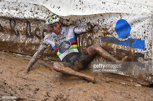 Netherlands' Mathieu Van Der Poel falls at the Grand Prix of Wallonia cyclocross race in Francorchamps on December 13 2015 celebrates as he crosses...