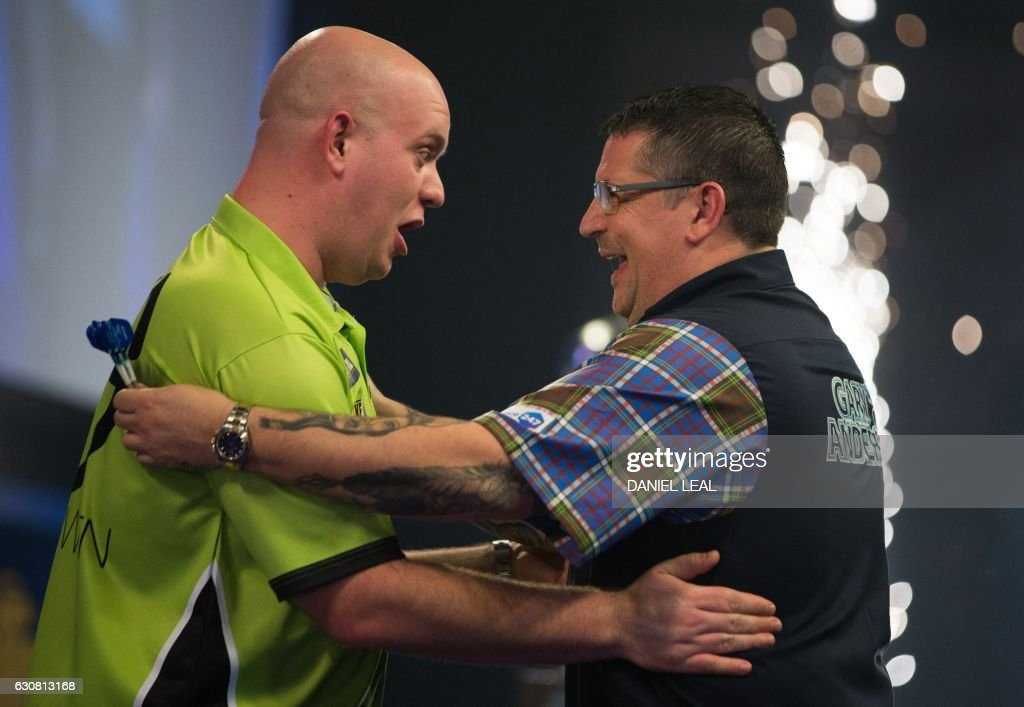 Netherlands' Michael van Gerwen (L) is congratulated by Scotland's Gary Anderson after his victory in the PDC World Championship darts final at Alexandra Palace in north London on January 2, 2017. Michael van Gerwen beat Gary Anderson 7-3 in sets to win the final. / AFP / DANIEL