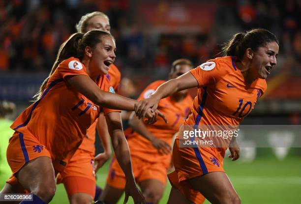 Netherlands' midfielder Danielle van de Donk celebrates after scoring a goal during the UEFA Womens Euro 2017 football tournament semifinal match...