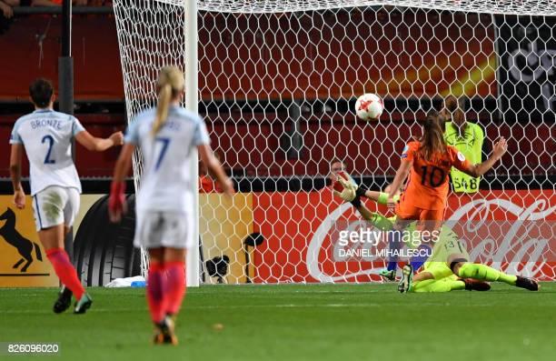 Netherlands' midfielder Danielle van de Donk shoots and scores a goal past England's goalkeeper Siobhan Chamberlain during the UEFA Womens Euro 2017...