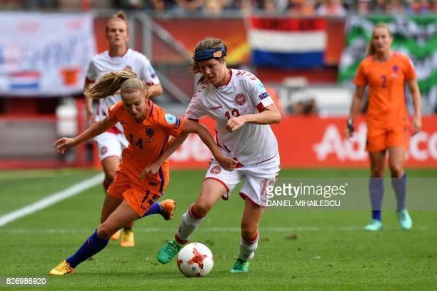 Netherlands' midfielder Jackie Groenen vies for the ball with Denmark's midfielder Sofie Pedersen during the UEFA Womens Euro 2017 football...
