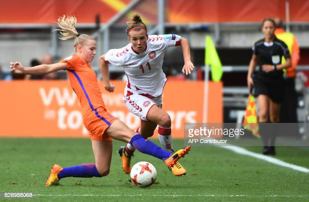 Netherlands' midfielder Jackie Groenen vies for the ball with Denmark's midfielder Katrine Veje during the UEFA Womens Euro 2017 football tournament...