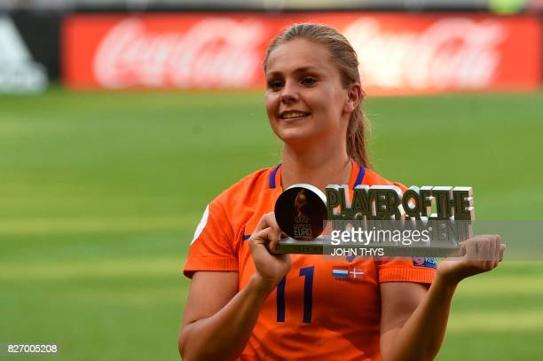 Netherlands' midfielder Lieke Martens celebrates with her trophy after receiving the best player award of the competition at the end of the UEFA...
