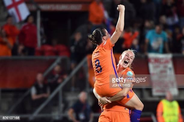TOPSHOT Netherlands' midfielder Sherida Spitse and Netherlands' defender Stephanie van der Gragt celebrate after their team's third goal during the...