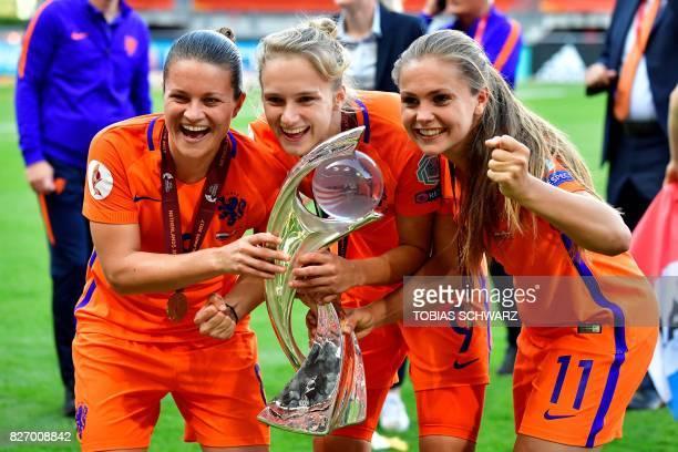 Netherlands' midfielder Sherida Spitse Netherlands' forward Vivianne Miedema and Netherlands' midfielder Lieke Martens pose together as they...
