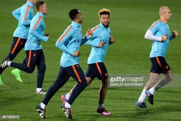 Netherland's midfielder Tonny Vilhena and forward Arjen Robben take part in a training session on the eve of the FIFA World Cup 2018 qualifier...