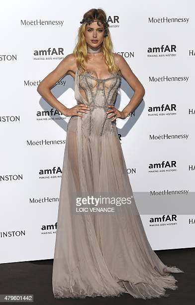 Netherland's model Doutzen Kroes poses prior to taking part in the AMFAR dinner on the sidelines of Paris fashion week in Paris on July 5 2015 AFP...